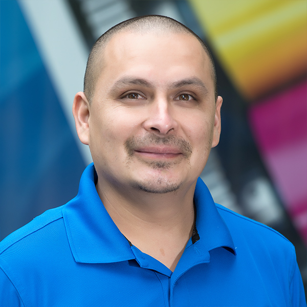 Printing team member Uriel Rincon, Production Specialist.